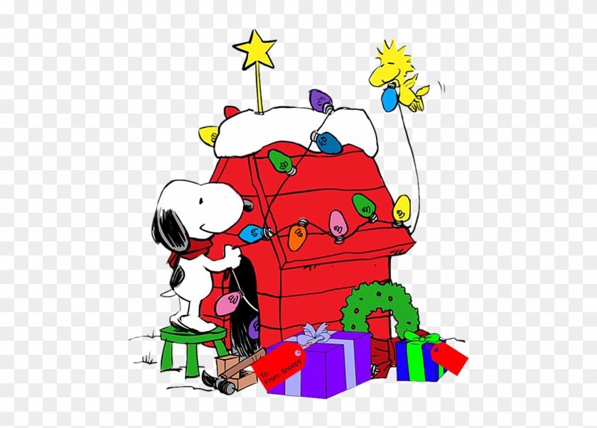 snoopy decorating his dog house with help from woodstock snoopy christmas dog house